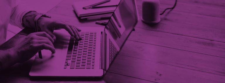 purple image male hands on laptop